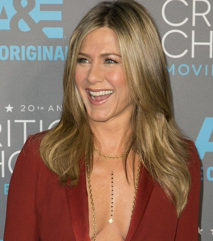 Jennifer Aniston's cleavage in a plunging androgynous red tuxedo