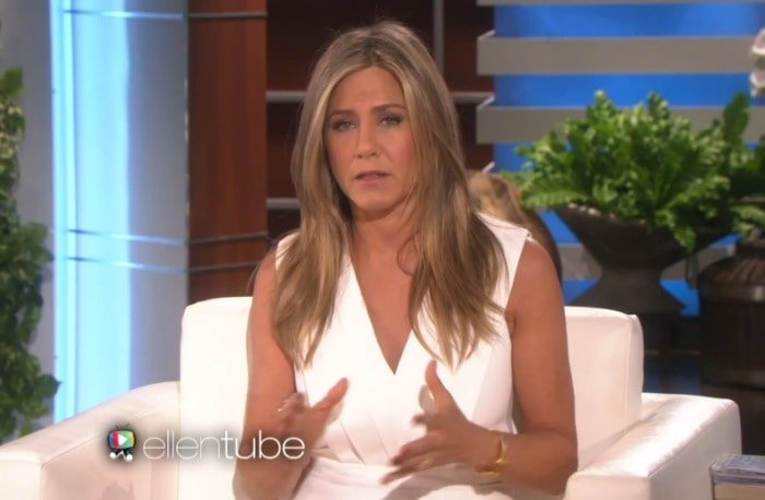Jennifer Aniston in a tight white crepe dress from Saint Laurent