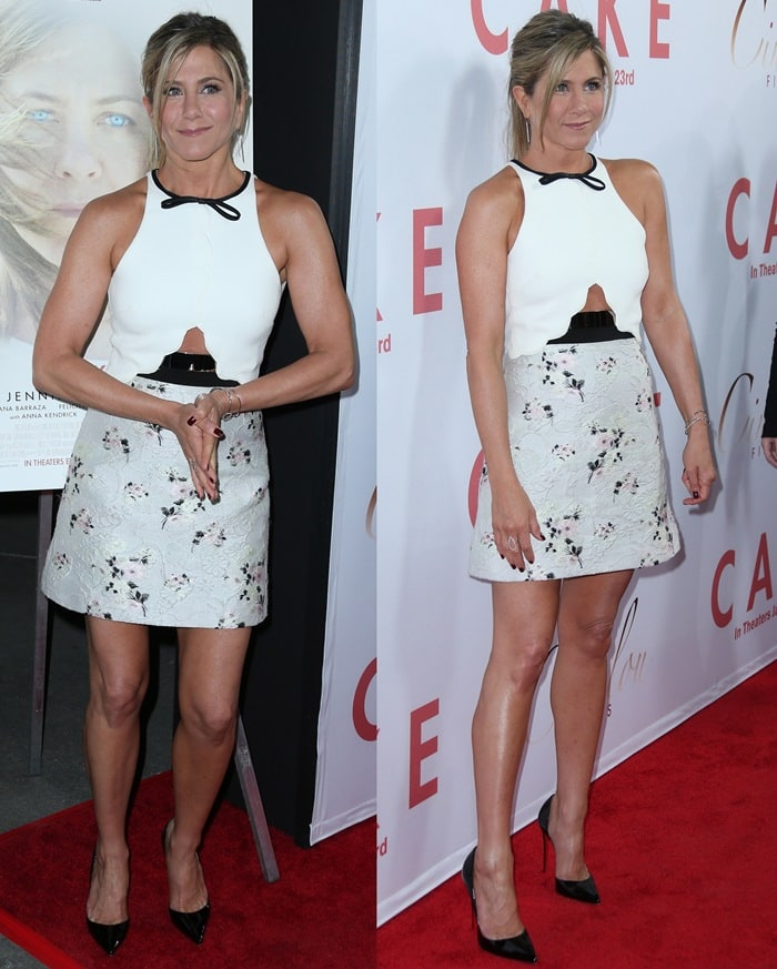 Jennifer Aniston paraded her legs in a floral jacquard silk crepe mini dress