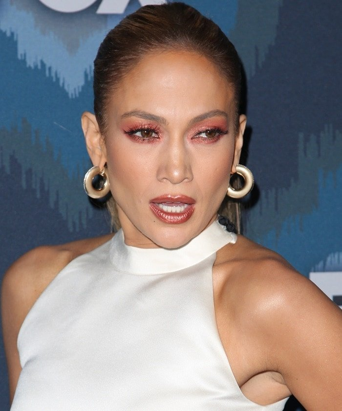 Jennifer Lopez wears a cropped white halter top from SisSae