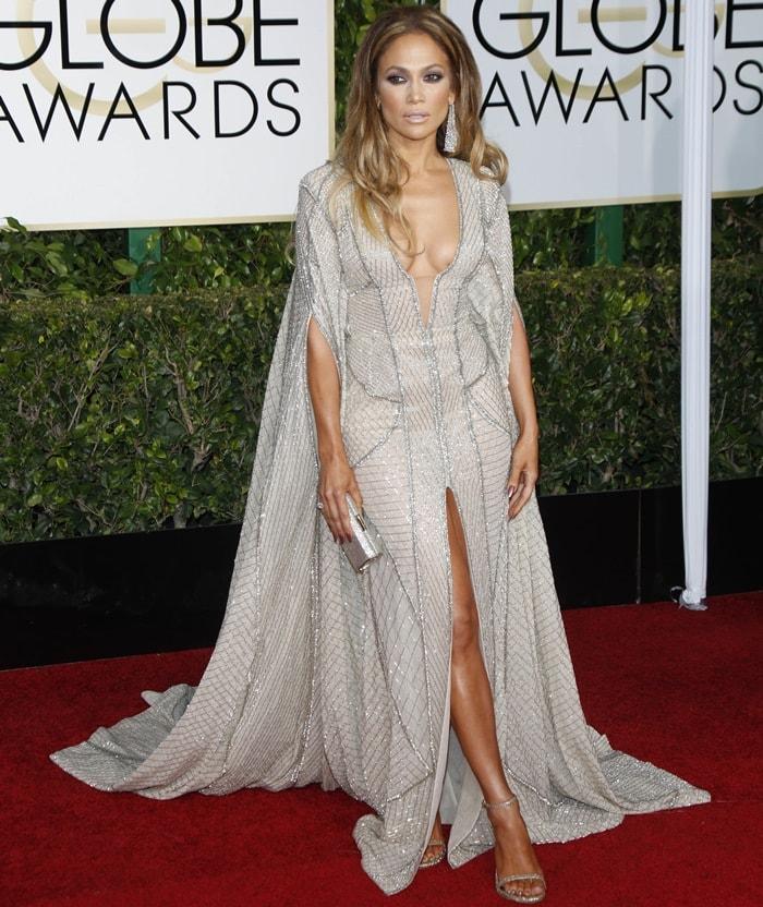 Jennifer Lopez flaunts her legs in a beaded sheer caftan dress