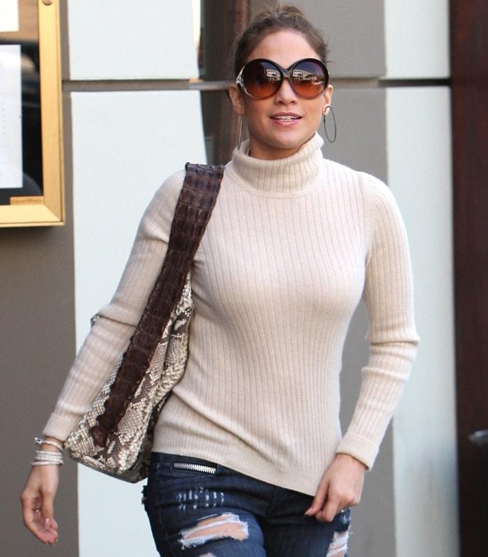 Jennifer Lopez'soversized hoop earrings and glamorous sunglasses