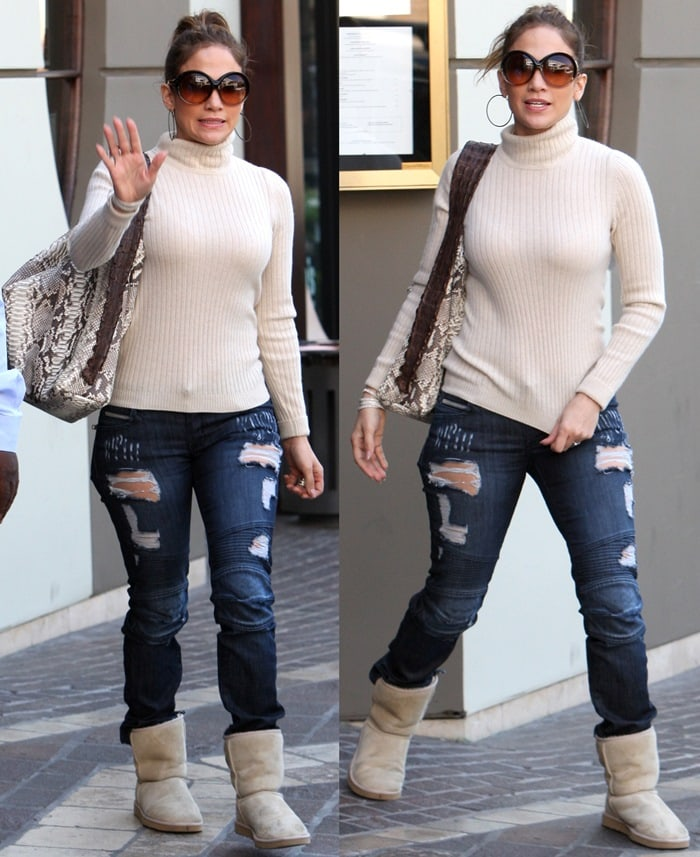 Jennifer Lopez in ripped jeans, tight sweater, and uggs leaving Wisper Lounge