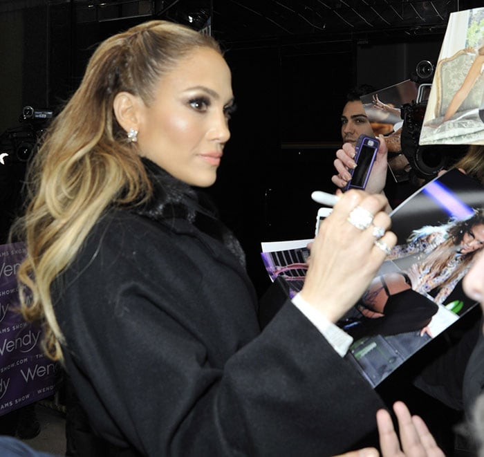 "Jennifer Lopez signs autographs for fans as she arrives at ""The Wendy Williams Show"""