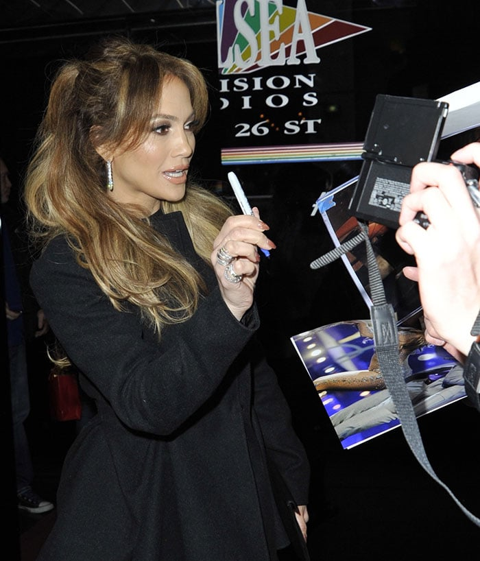 Jennifer Lopez signs autographs for fans in an all-black look