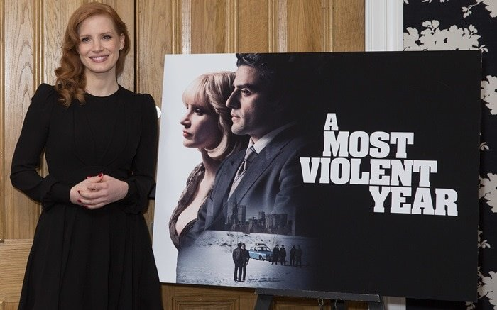 Jessica Chastain in a black dress from Saint Laurent featuring a nipped in waist