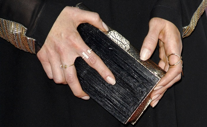 Bellamy Young toteda clutch by Kara Ross and accessorized with jewelry by Eva Fehren and Jennifer Fisher