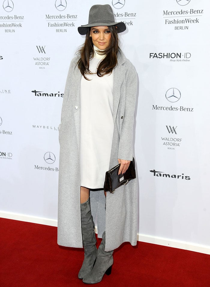 Katie Holmes rocked a high-neck dress, a gray duster coat, a wide-brimmed hat, and slouch boots