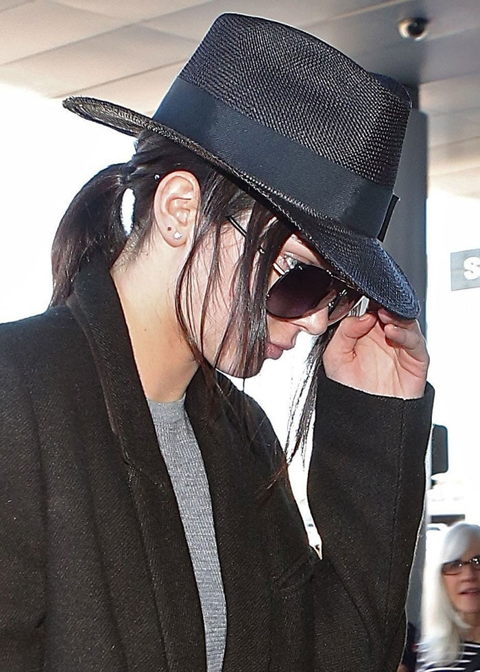 Kendall Jenner's fedora hat and trench coat by Haider Ackermann