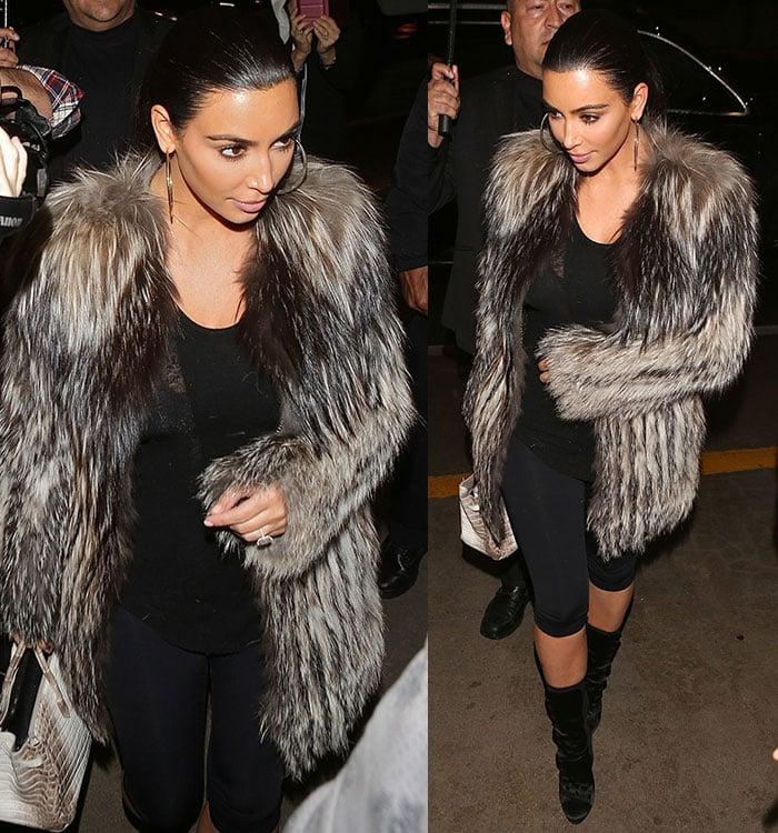 Kim Kardashian wore her hair in a slick ponytail