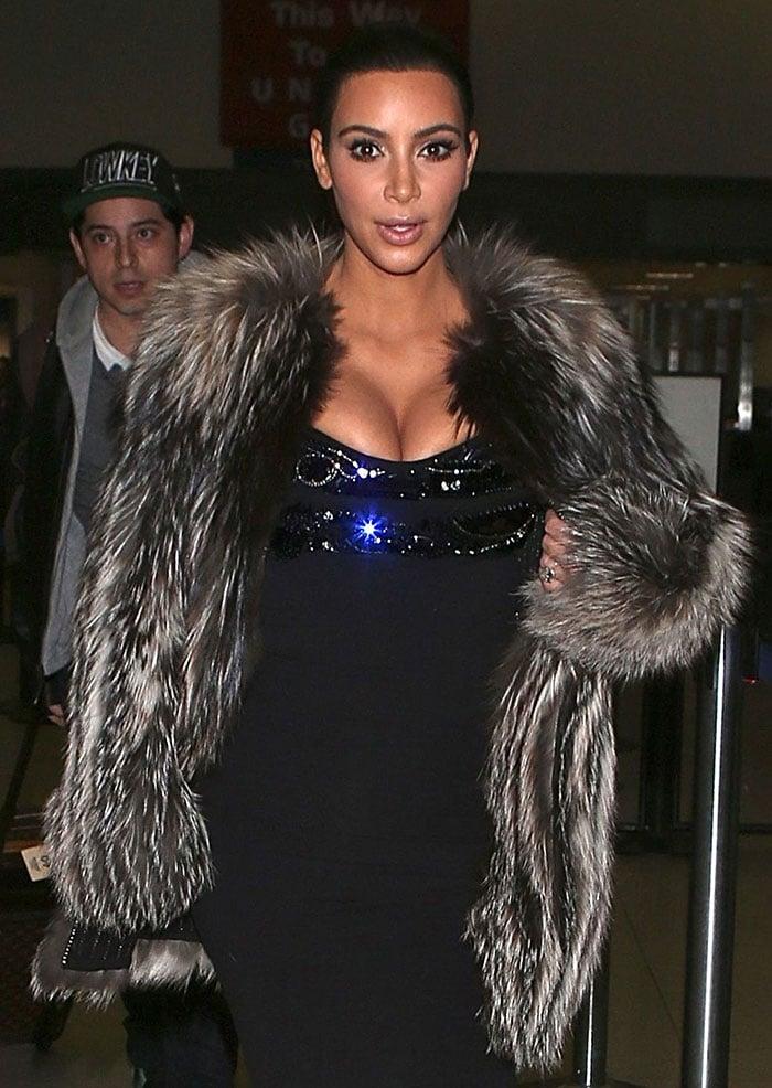 Kim Kardashian flashing her cleavage at LAX on January 11, 2015