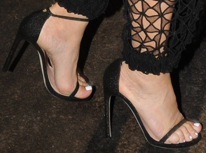 Kris Jenner's feet in towering ankle-strap sandals