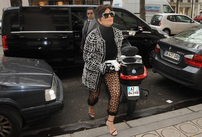 Kris Jenner shopping at the Yves Saint Laurent store in Paris wearing see-through mesh pants and carrying a Chanel clutch bag on January 27, 2015