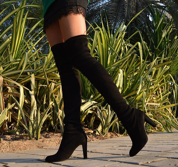 Laura's sexy black Stuart Weitzman over-the-knee boots