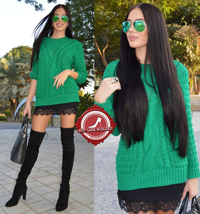 Laura flaunts her legs in a green knit sweater paired with a black lace-hemmed miniskirt