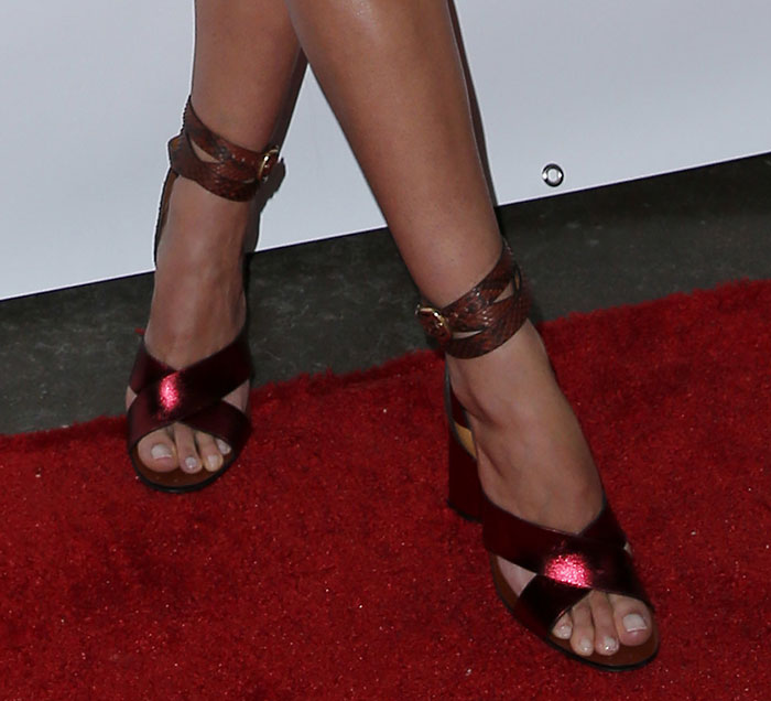 Lily Aldridge's metallic red sandals with snakeskin buckled ankle-wrap straps