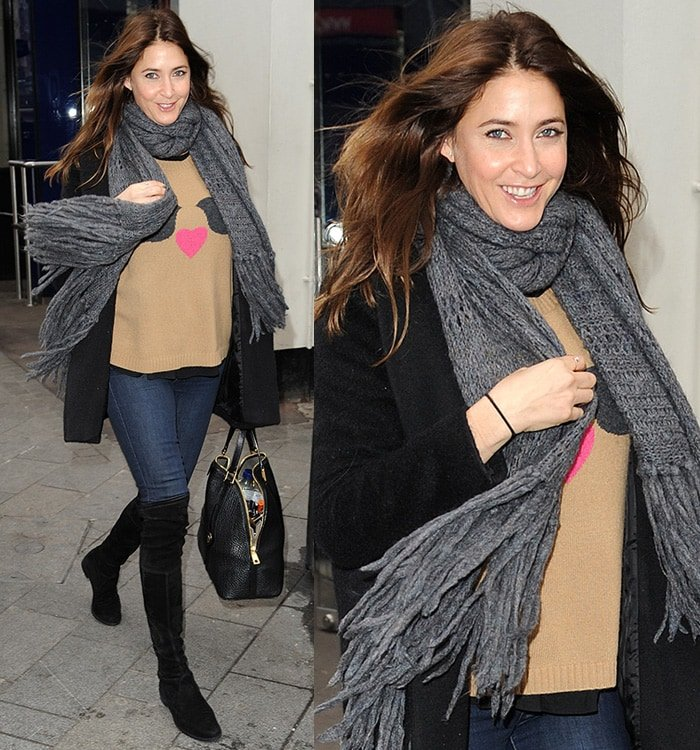 Lisa Snowdon wears thigh-high boots with jeans