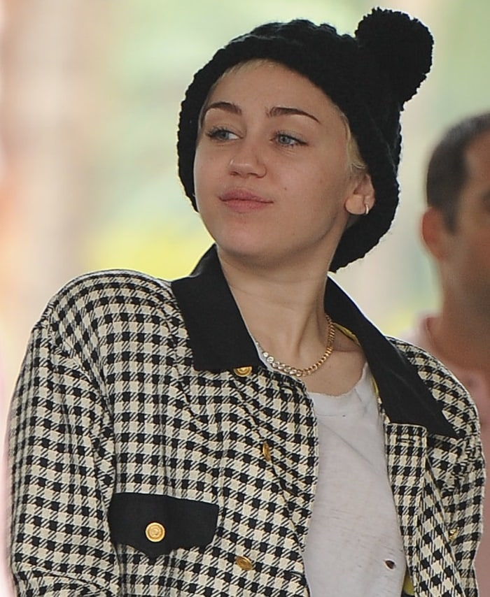 Miley Cyrus'swhite houndstooth vintage jacket andcat ears beanie