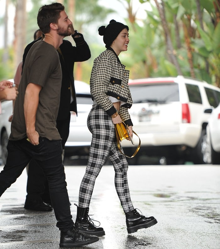 Miley Cyrus and Patrick Schwarzenegger arrive at The Beverly Hills Hotel
