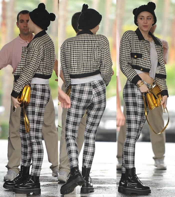Miley Cyrus in block check denim leggings andboots from Agyness Deyn For Dr. Martens