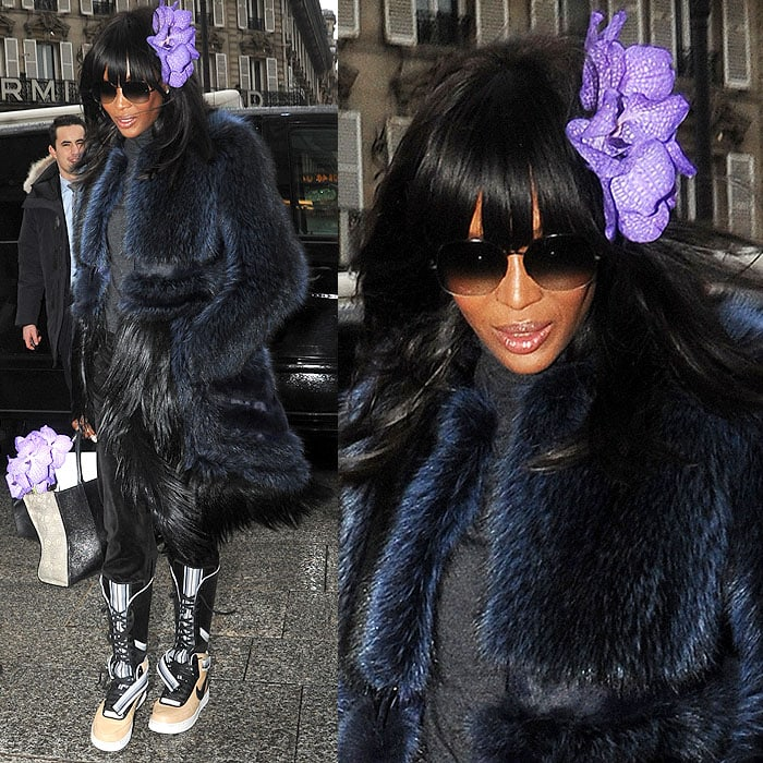 Naomi Campbell with a purple flower in her hair