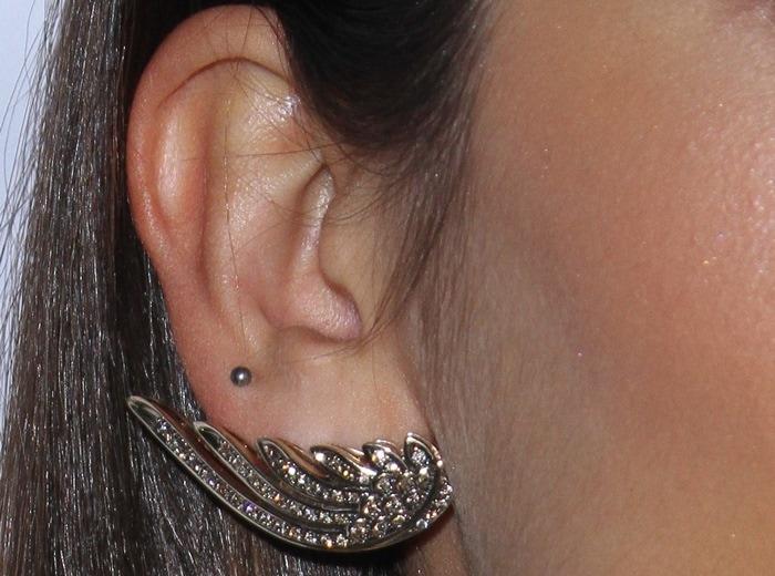 """Nina Dobrev wears H. Stern 18-karat Noble gold """"Wings"""" earrings"""