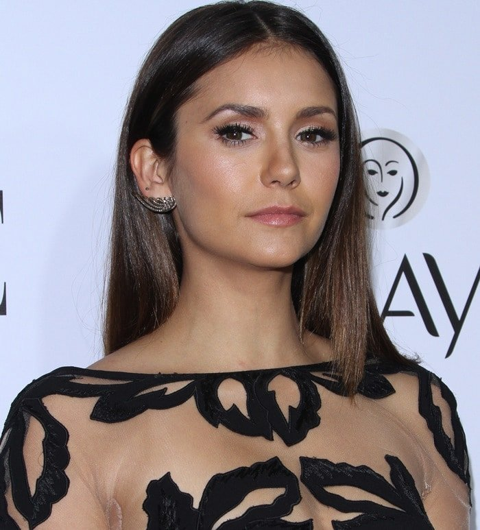 Nina Dobrev wears her hair down at the Elle Women in Television Celebration