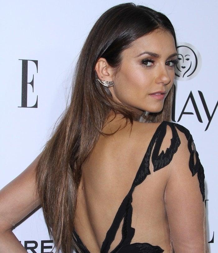 Nina Dobrev shows off her back in a Zuhair Murad jumpsuit