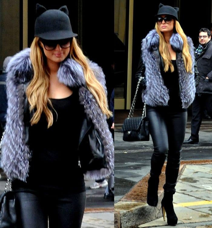Paris Hilton wears Rag & Bone leather pants with a quirky Helene Berman cat ears cap in Milan