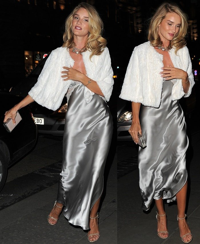 Rosie Huntington-Whiteley dressed in an ankle length silk nightdress and covered up with a tiny a white bolero