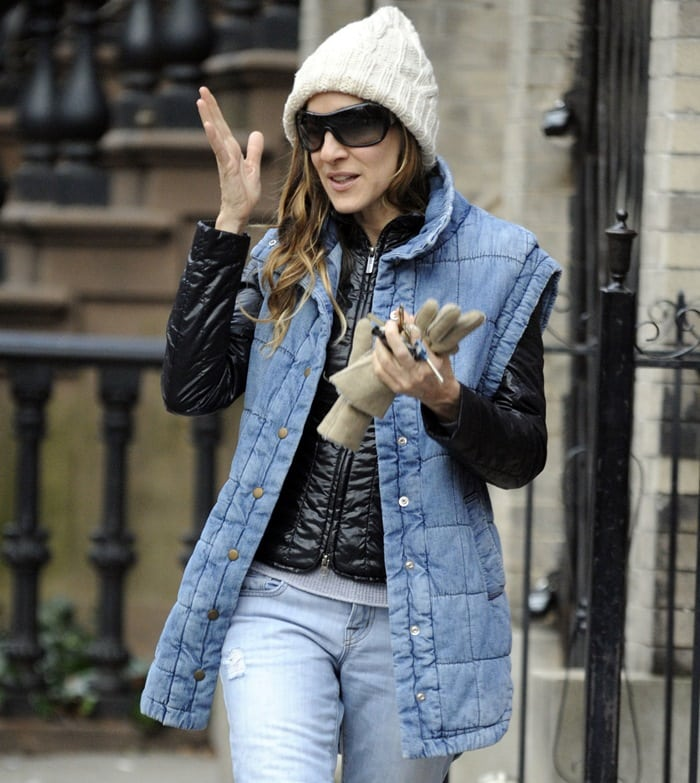 Sarah Jessica Parker in a denim vest from Anthropologie, a white wool hat, and trendy sunglasses