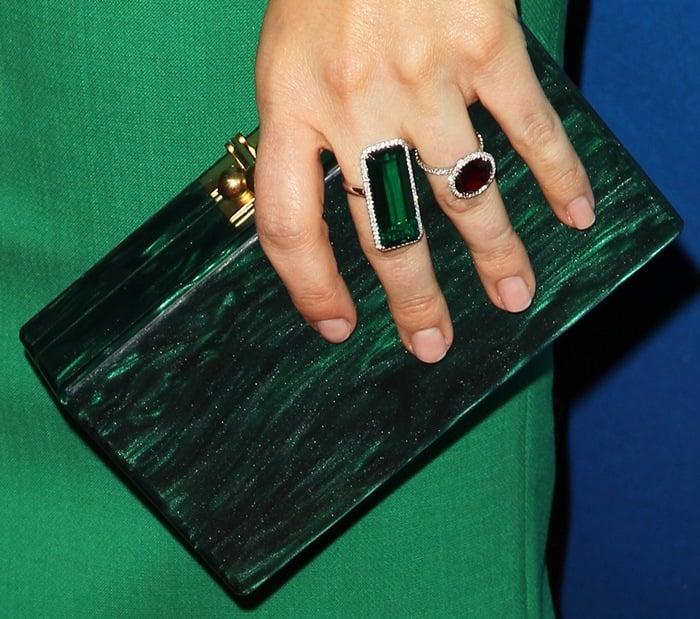 Sophia Bush totes an emerald-green Edie Parker Jean clutch