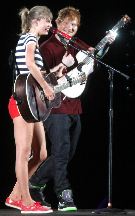 Taylor Swift brings out her guitar to perform with musician Ed Sheeran