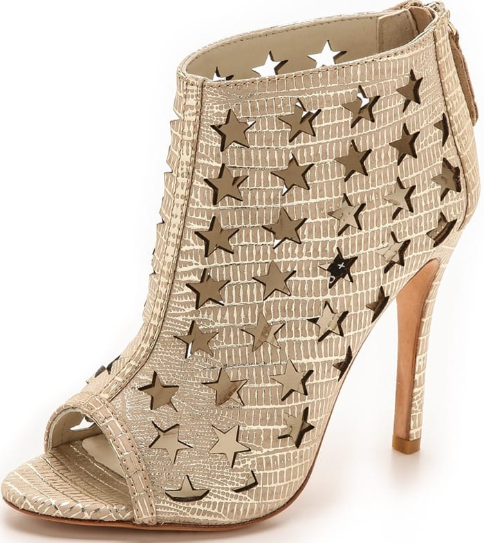A soft metallic wash accentuates the lizard-embossed texture on nubuck booties