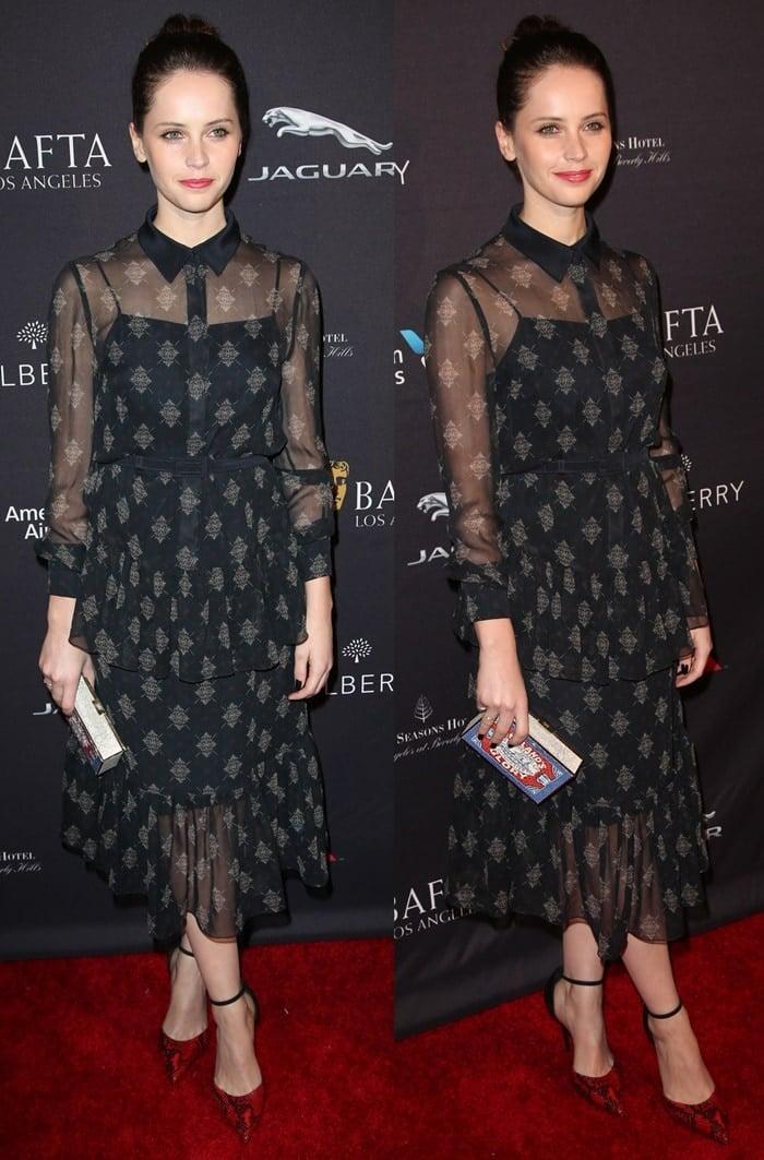 Felicity Jones flashes her toned legs in a feminine Erdem dress