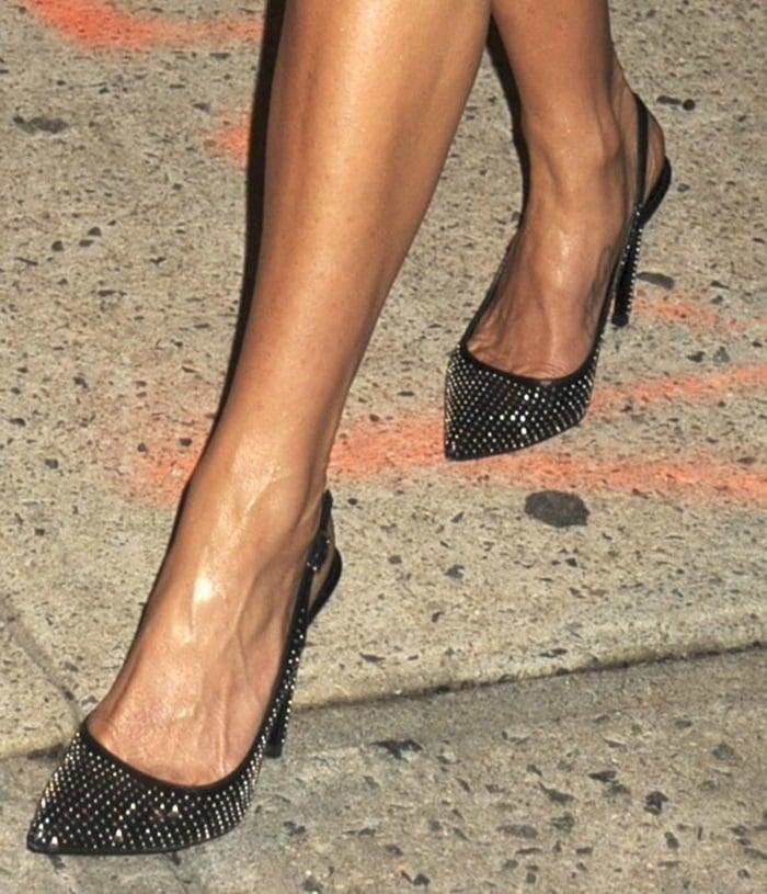 Jennifer Aniston's feet in studded Saint Laurent pumps