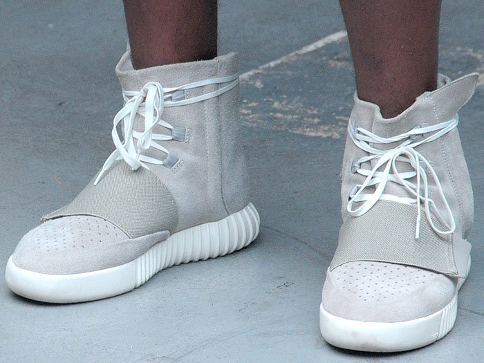 """The Adidas Originals x Kanye West Yeezy """"750 Boost"""" sneakers on a model"""