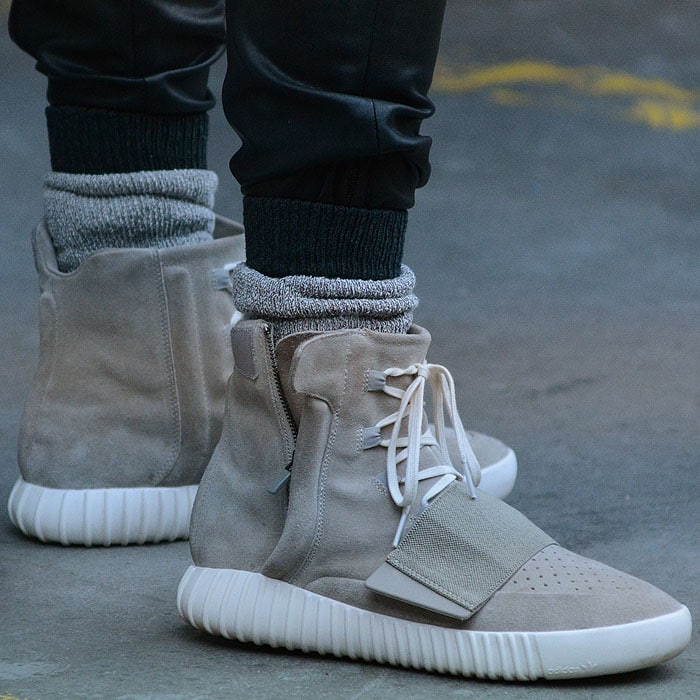 """A male model wearing the Adidas Originals x Kanye West Yeezy """"750 Boost"""" sneakers"""