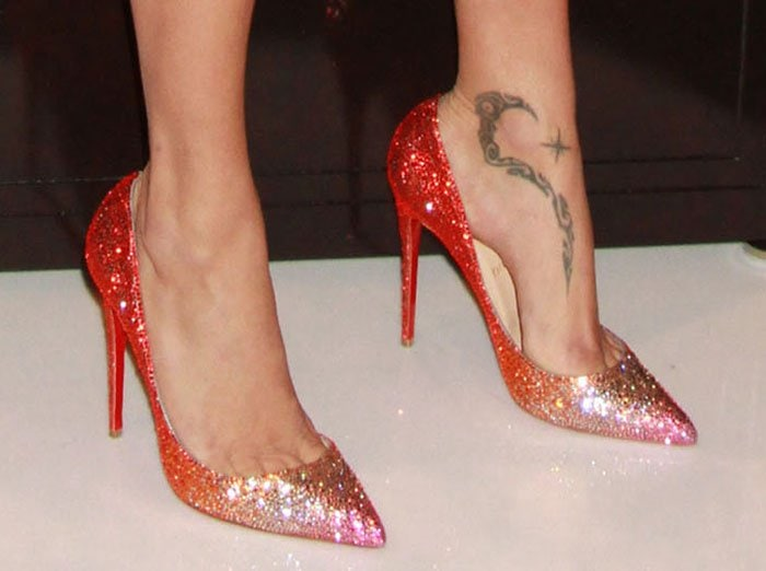 Adriana Lima's space-alien-space-monster tribal foot tattoo