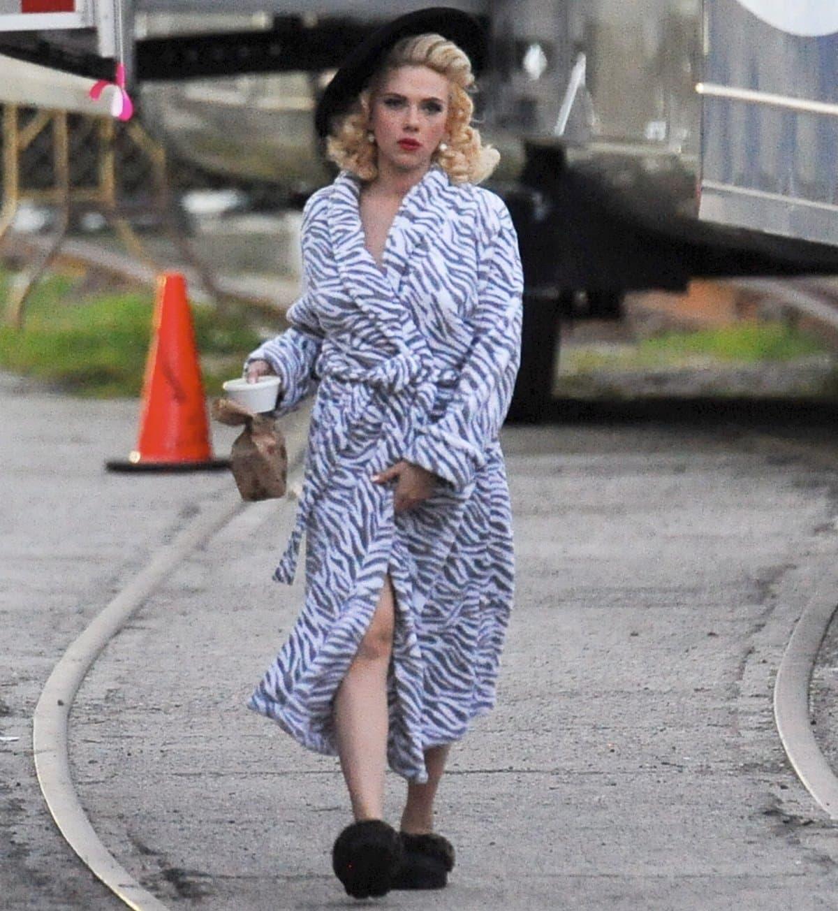 Blonde bombshell Scarlett Johansson wears a zebra print bathrobe on the set of Hail, Caesar!