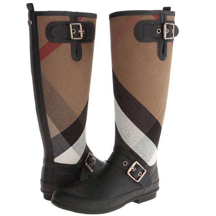 Exploded checks lend signature élan to a stylish rain boot detailed with shining square buckles