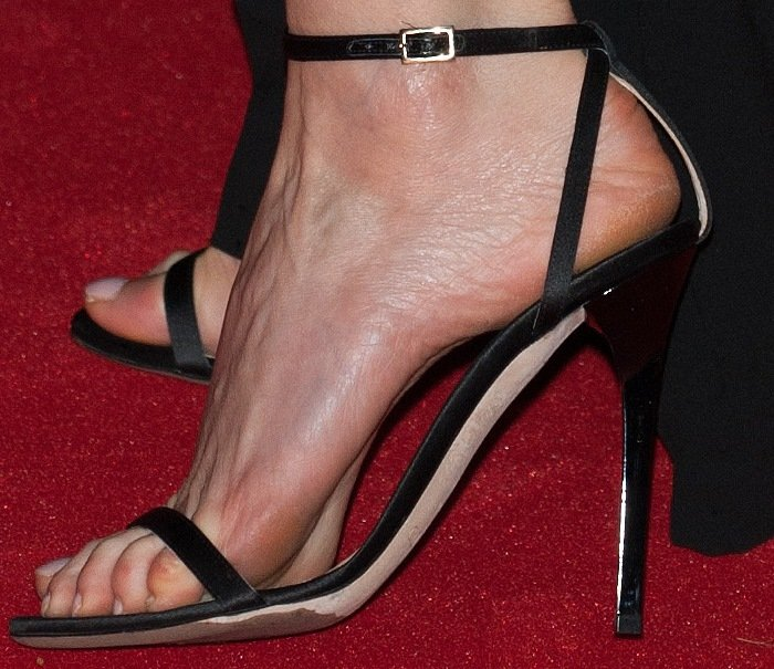 Charlize Theron added inches to her height with black stiletto heels