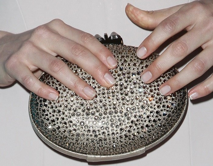 Emmy Rossum carrying a glittering clutch from Christian Louboutin