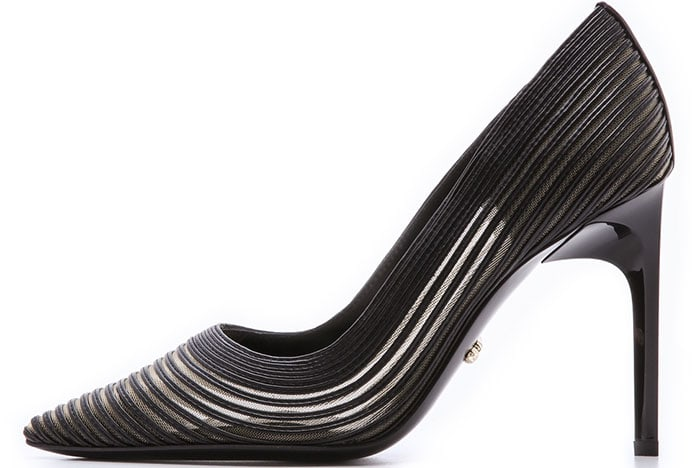 The pointed-toe silhouette has a glossy stiletto heel for a cool shine