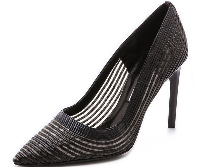Sheer mesh peeks through strips of leather on these DVF pumps