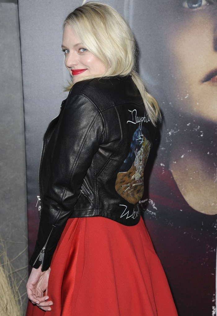 Elisabeth Moss in a red dress and leather jacket from Christian Dior