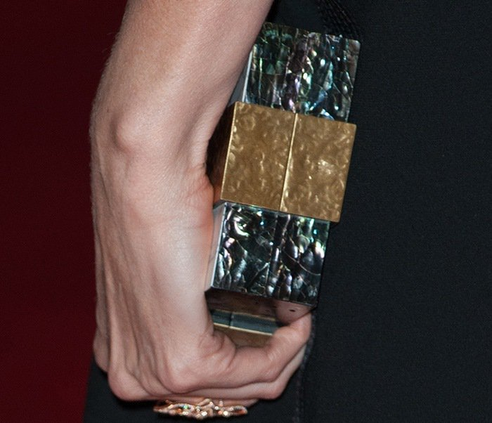 Charlize Theron toted an Emm Kuo clutch