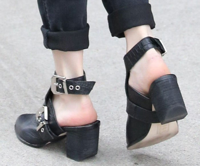 Emma Roberts shows off her feet in a hybrid between mules and booties