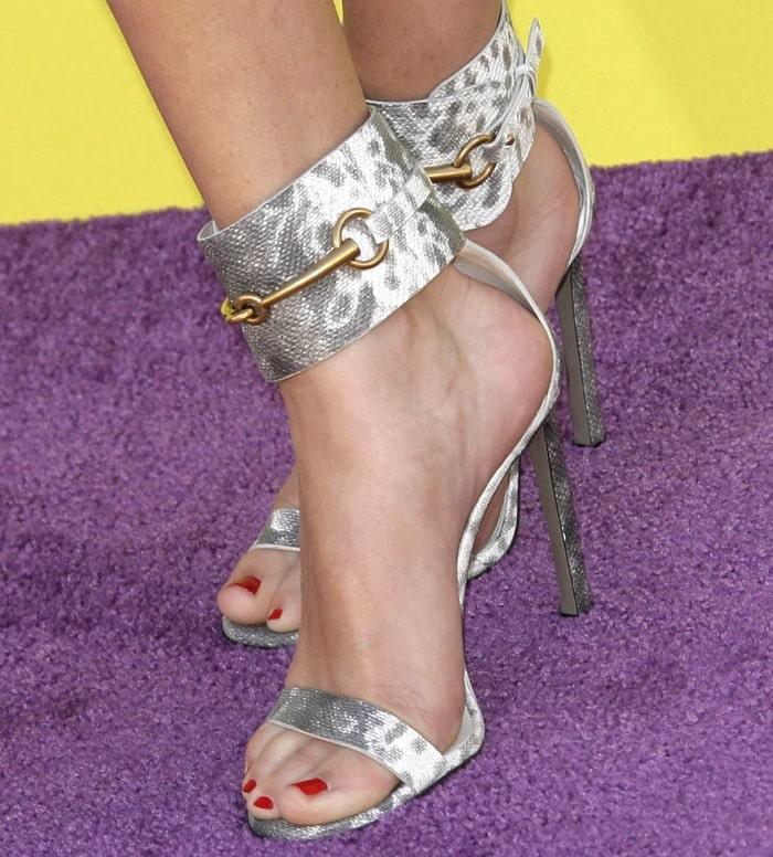 Selena Gomez wearing karung-printed leather sandals