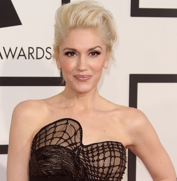 Gwen Stefani's black jumpsuit with an artistically structural and embellished corset bodice